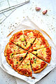 Cauliflower crust pizza slices (16863229570).jpg