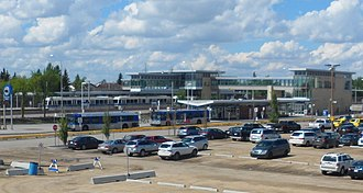 Century Park station (Edmonton) - An overview showing the transit centre in front of the LRT station and the connecting pedestrian bridge