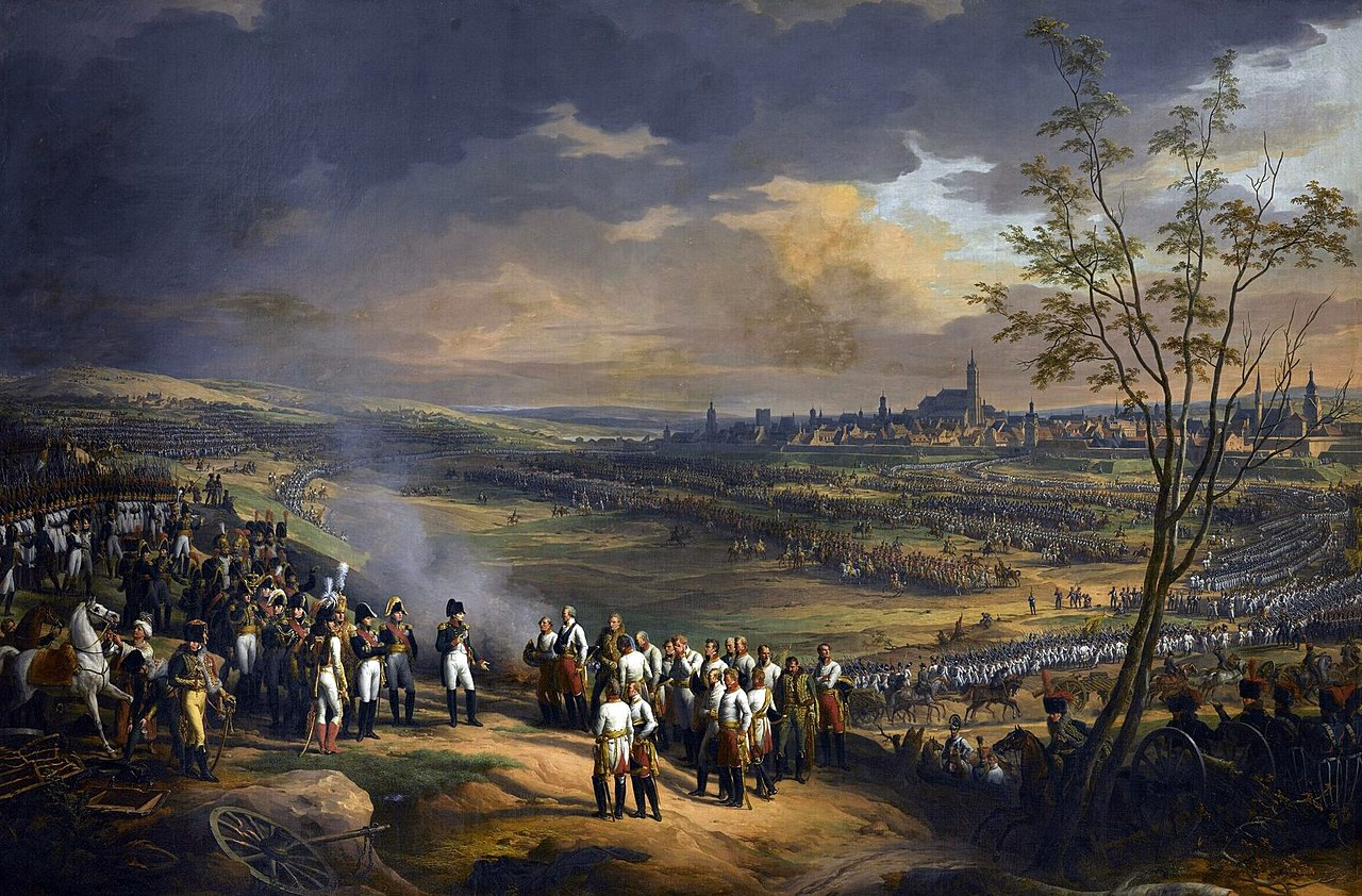 Colored painting depicting Napoleon receiving the surrender of the Austrian generals, with the opposing armies and the city of Ulm in the background.