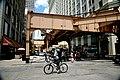 """Chicago (ILL) Downtown, S Wells St. W Van Buren St. """" under the Loop, biker & pesdestrians """" (4823644031).jpg"""