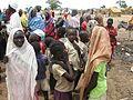 Children queue for water in the Jamam refugee camp (7118755769).jpg