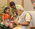 Children tying 'Rakhi' on the Prime Minister, Shri Narendra Modi's wrist, on the occasion of 'Raksha Bandhan', in New Delhi on August 29, 2015 (11).jpg