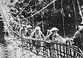 Chinese troops crossing suspension bridge.jpg