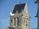 Church tower of Église de Sainte-Mère-Église (3).jpg