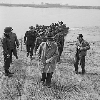 Churchill in his 4th Queen's Own Hussars colonel's uniform crossing the Rhine, 25 March 1945 Churchill on the east bank of the Rhine.jpg