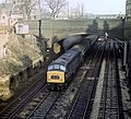 """Class 45 """"Peak"""" 1Co-Co1 diesel locomotive no. 45107 departs from Leicester station, Nigel Tout, 17.1.76.jpg"""