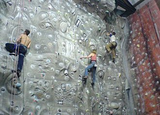 Climbing wall - An indoor rock climbing wall in the UK showing moulded features and coloured route markers