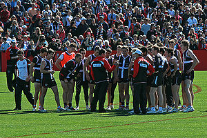 Coach Ross Lyon (centre) addresses the St Kild...