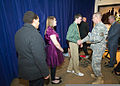 Col. Charles Williams, center, garrison commander of Fort Leonard Wood and Dan Arden, right, Fort Leonard Wood Lions Club vice president, congratulates members of the Saint James Boys and Girls Town Choir on 111213-A-WN220-187.jpg