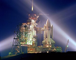 Space Shuttle Columbia on launch pad at night