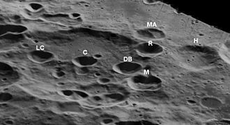 Apollo (crater) - The craters L. Clark (LC), Chawla (C), D. Brown (DB), M. Anderson (MA), McCool (M), Ramon (R), and Husband (H).  Lunar Orbiter 5 image.