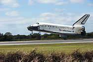 Concluding the STS-133 mission, Space Shuttle Discovery touches down at the Shuttle Landing Facility.jpg
