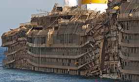 Starboard side of the righted Costa Concordia, showing the crushing impact of the rock spurs upon which it rested.