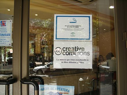 A sign in a pub in Granada notifies customers that the music they are listening to is freely distributable under a Creative Commons license. Creativecommons spanien.jpg