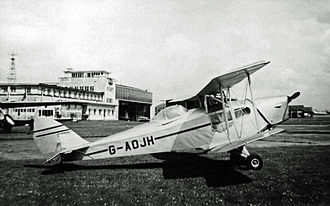 De Havilland Canada - Canadian-built DH.83C Fox Moth with canopy fitted to pilot's position at Manchester (Ringway) Airport in 1955