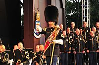 The U.S. Army Band drum-major shown with choir behind him.