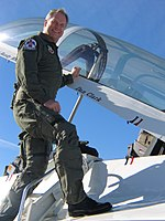 Dan Clark in a flight suit on a jet fighter.jpg