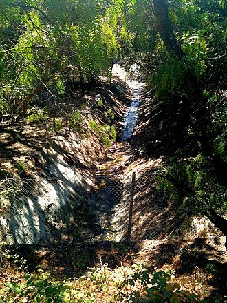Matadero Creek - Deer Creek just east of Arastradero Road runs in a concrete trapezoidal channel along I280, preventing the creek's water from replenishing the groundwater table Aug. 29, 2010