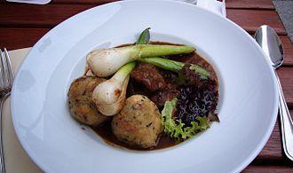 Goulash - Venison goulash with dumplings, leeks and lingonberry sauce