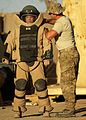 Defense.gov News Photo 110506-F-AU128-129 - U.S. Air Force Staff Sgt. James Weber right an explosive ordnance disposal technician with the 11th Civil Engineer Squadron assists Staff Sgt.jpg
