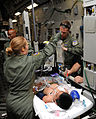 Defense.gov News Photo 110522-F-FD024-101 - Master Sgt. Molly Quentin and Capt. John-Michael Fowler care for a critically ill patient on a medical evacuation mission from Pago Pago American.jpg