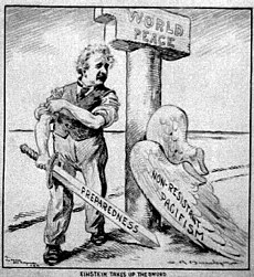 "Cartoon of Einstein, who has shed his ""Pacifism"" wings, standing next to a pillar labeled ""World Peace"". He is rolling up his sleeves and holding a sword labeled ""Preparedness""."