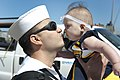 Flickr - Official U.S. Navy Imagery - A Sailor greets his newborn child after returning..jpg