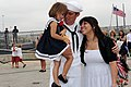 Flickr - Official U.S. Navy Imagery - A Sailor receives the first hug from his daughter and wife, Angeleia, during a homecoming celebration..jpg