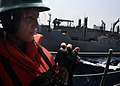 Flickr - Official U.S. Navy Imagery - Sailor stands phone-talker watch aboard USS Bataan during a replenishment at sea.jpg