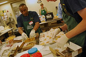 Catholic Charities USA - Sailors preparing lunch at Our Daily Bread Employment Center during Fleet Week