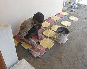 Labour in India - Flooring work at a Portico in Hyderabad, India