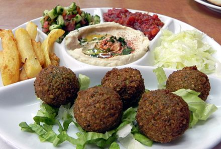 A meal including falafel, hummus, French fries and Israeli salad Food in Israel.jpg