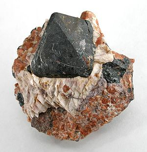 Franklinite - Franklinite (black) with Zincite (red)