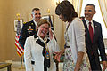 From right, President Barack H. Obama, first lady Michelle Obama, Brenda Linnington and U.S. Army Maj. Gen. Michael S. Linnington, the commander of the Military District of Washington, laugh inside the Memorial 130527-A-VS818-223.jpg