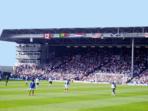 History of Fulham F.C. - Fulham (White) playing Portsmouth (Blue) in front of Fulham fans in the Hammersmith End.