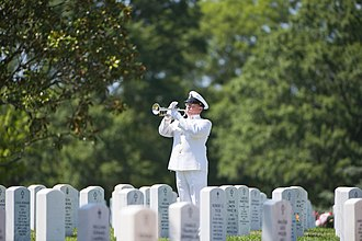 Taps - a bugler from the U.S. Navy Band, plays taps during the graveside service in Arlington National Cemetery.