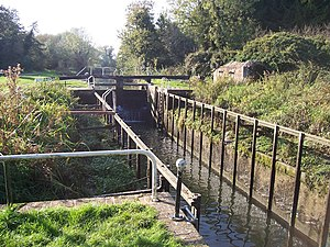 John Hore - Garston Lock is one of two remaining turf-sided locks on the canal, although it has been reduced in dimensions since its original building