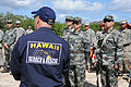 Gary Wiegand, front left, with the Hawaii State Civil Defense Urban Search and Rescue Canine Unit discusses search and recovery with Chinese and U.S. Soldiers during Disaster Management Exchange 2013 at the U.S 131112-A-NV268-014.jpg