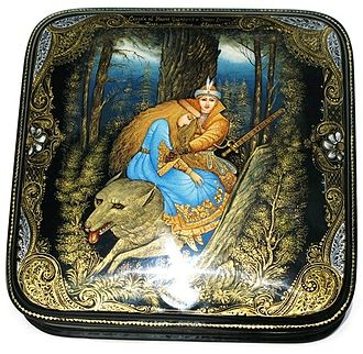 Russian lacquer art - A Palekh jewellery box depicting a scene from the fairy tale Tsarevitch Ivan, the Fire Bird and the Gray Wolf