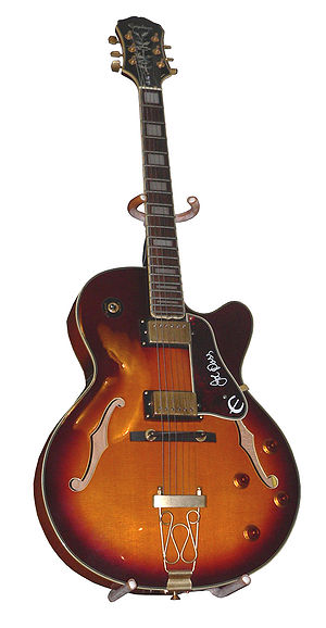 "Jazz guitar -  A hollow-bodied Epiphone guitar with violin-style ""F"" holes."