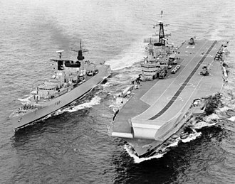 British naval forces in the Falklands War - The flagship of the Carrier Group, HMS Hermes, alongside HMS Broadsword