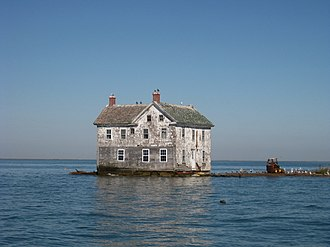 Tidal flooding - The last remaining house on Holland Island that collapsed and was torn down in the 2010s as erosion and tides reached the foundation.