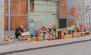 Homless selling flowers in São Paulo downtown.jpg