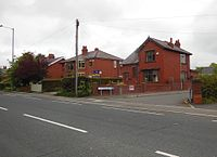 Houses on the A6 Preston Road (geograph 4491628).jpg