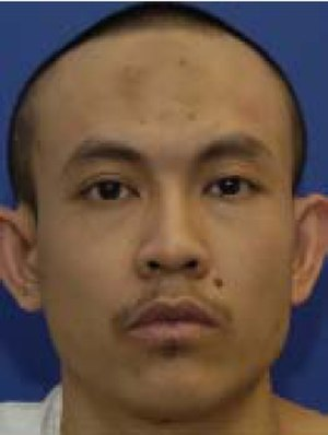 Mohamad Farik Amin - Guantanamo captive Mohd Farik Bin Amin wearing the white uniform issued to compliant captives.