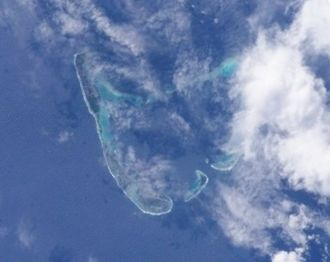 Addu Atoll - Addu Atoll seen from space. Note the continuous reef fringing Addu from the west and southwest.