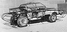Imperial War Museum photograph of a jeep fitted with the frame of a dummy tank in the desert near Cairo, 1942