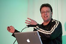 Ian hughes speaking at 2009 conference.jpg
