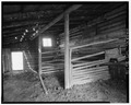 Interior- South bay of Barn showing cattle stalls - T. A. Moulton Ranch, Mormon Row Road, Kelly, Teton County, WY HABS WYO,20-KEL.V,2-12.tif