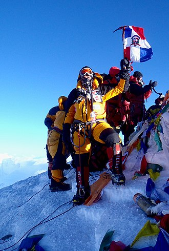 Summit - Climbers on the world's highest summit, Mount Everest, at 8,850 metres (29,035 ft) above sea level.